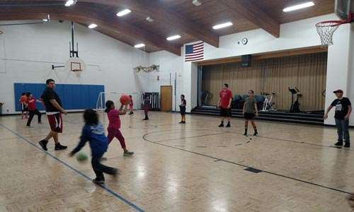 Kids working on their basketball passing skills
