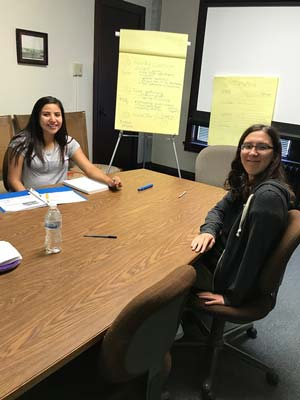 Youth interns at a conference table