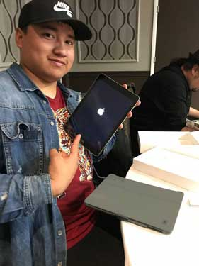 Kendrick Eagle receives new iPad at Dreamstarter Academy