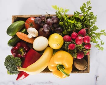 Box full of fresh vegetables.