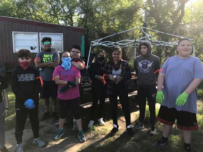 Youth pose with their paintball team.