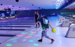 Native youth bowling.