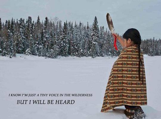 A Native child wrapped in a blanket stands in the snow, holding aloft a feather.