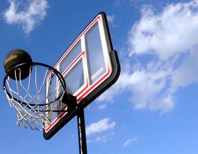 A basketball flies through a hoop