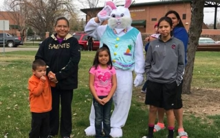Easter Bunny poses with families at the SPRC Easter Egg Hunt