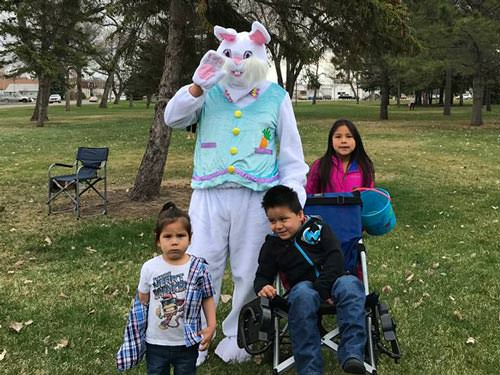 Easter Bunny poses with a group of kids at the SPRC Easter Egg Hunt
