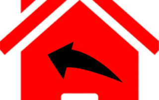 red house with black arrow over it