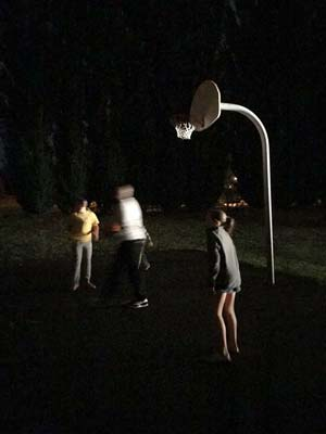 Kids playing midnight basketball at Quest Talk