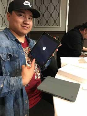 Kendrick Eagle receives new iPad at Dreamstarter Academy