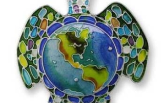 Enamelled pin of sea turtle carrying earth on its back.